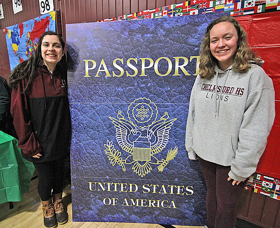 """. Doing the \""""passports\"""" for the Harrington School Heritage Festival are student volunteers, L-R, Maura Maguire, 16, and Hannah Mattsen, 17, both juniors at Chelmsford High School. SUN/ David H. Brow"""
