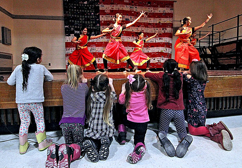 . Young fans get a front-row view of dancers from the Natyaman School of Dance of Westboro at the Harrington School Heritage Festival. SUN/ David H. Brow