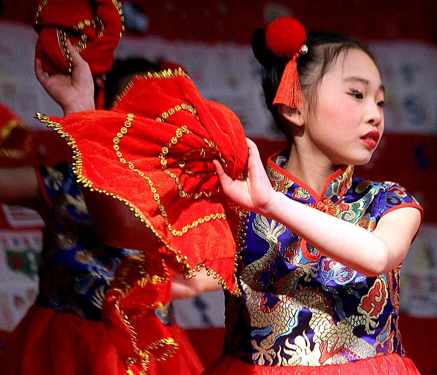 . A young dance troupe member from the Chelmsford Chinese Language School, dancing at the Harrington School Heritage Festival. SUN/ David H. Brow