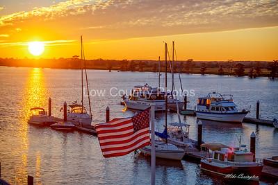American Flag over Heritage Marina