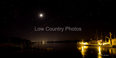 Night scene of the Heritage Plantation marina with stars and moon showing in the night sky.