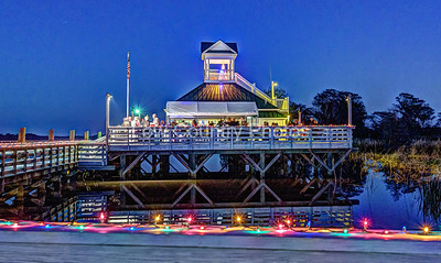 "The Annual ""Get Lit"" party at Heritage Plantation Marina when all the boat owners decorate their boats for Christmas."
