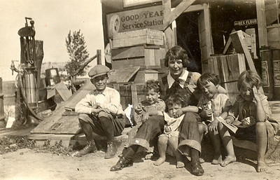 Circa 1925   That's Coalwood School marm, Miss Choate, on the steps of the Mercantile, surrounded by a gaggle of Janssen children:  Bille, son of Fred & Lois (GRAHAM) Janssen, is on the left. (Fred and Bill were brothers.) Bill & Hallie's first born, Floyd, is next. Virginia is snuggled in Miss Choate's lap. Virginia was Bill & Hallie's only daughter. Virginia died at seven years of age, from injuries sustained when she fell from a truck and was run over. Bill was driving, hauling water from a nearby spring. The two girls on the right are Rowena and Dorothy, Fred & Lois' daughters.  Fred and Lois lived a stone's throw from the Mercantile.