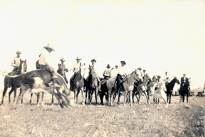 Rodeo at Coalwood Circa 1925   (NOTE: No arena. Horseback cowboys serve to confine the action. That's Johnny Peterson toward the right who is dressed as a woman.)
