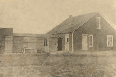 First Coalwood Post Office Built to the left of log cabin Circa 1913   In 1912, John W. Janssen was appointed postmaster and opened a post office next door to his home. In addition to handling the mail, he also sold tobacco, paper, pencils and ink.  (NOTE: House has doubled in size with addition of second floor)  -----------   A 1915 Post Guide lists Miles City as a Sectional Center for southeastern Montana, serving 35 post offices in this area as a receiving and distribution facility. Only four other post offices (Kinsey, Ismay, Locate and Volborg) besides Miles City remain in Custer County out of the 24 post offices in operation in 1915:  Beebe. Broadus. Calabar, Coalwood, Garland, Graham, Hillcrest, lsmay, Kimball, Kingsley, Kinsey, Knowlton, Meredith, Miles City, Mizpah, Moorhead, Olive. Otter, Pinto, Powderville, Selway, Shirley. Stacey, and Stone Shack.   FROM HISTORY OF THE MILES CITY POST OFFICE:   http://www.milescity.com/History/stories/fte/historyofpostoffice.asp: