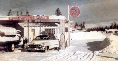 1952: That's my dad, John Janssen's, Cadillac fueling up at the Union 76 station in West Yellowstone. This was taken on the way back from a trip to Albuquerque, New Mexico, and California. Dad's friend, Bob Rask, represented Montana State College at an intercollegiate rodeo convention, and they took Dad's car. On the way back, they made a swing through California and took in the Tournament of Roses Parade.  Dad and Bob were plenty happy to see West Yellowstone. They had spent the night in the car, the road blocked by a truck stuck on a hill between Ashton, Idaho and West Yellowstone. It was a long, cold night.