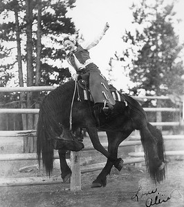 This photo, taken at a West Yellowstone photo concession, is of my mother, Alice Campbell. Taken in 1946, she was vacationing in the park with her family. (She and my father married in 1953.)  Too bad the photographer didn't make sure the bronc rein was on the right side of the horse's neck. It would have made for a more realistic shot.