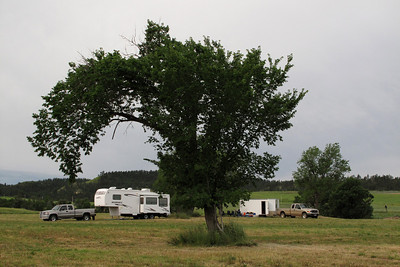 (Looking west/southwest from where the barns and corrals were)  The fifth wheel camper is parked where John and Anna's frame house stood. The cargo trailer is parked smack-dab over the spot where the outhouse stood.