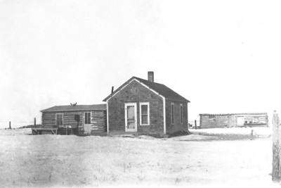 John W. Janssen Homes Subsequent to dugout  Note: buffalo skull on roof of cabin Barn to the right