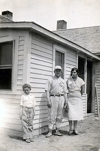 "John M. , Wm. M. ""Bill"" (in Coalwood baseball uniform) & Hallie Janseen in front of home Circa 1930"