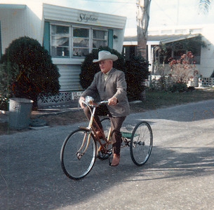 Peddle Power: circa 1972  Riding in Trade Winds Trailer Park, Bradenton, Florida   Granddad Bill was like a kid with a new toy with this set of wheels. You would have thought it was a Harley Davidson. (He sent Polaroid pictures for all of us to see!) I suppose he went this route so he wouldn't have to trade his cowboy hat for a helmet.  Granddad's last trip home from Bradenton was aboard a commercial aircraft--in a casket. He died in Sarasota Hospital from complications of brain cancer surgery in the spring of 1977.   His body was flown home for burial in the Custer County Cemetery, Miles City. He was laid to rest alongside his daughter, Virginia.