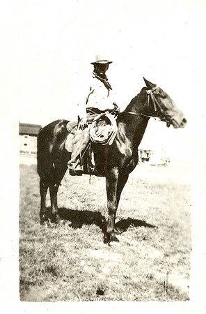 """Wild Horse Rider: 1917   William Janssen, at 20 years of age, shortly before enlisting in the Navy  He enlisted prior to American's official involvement in WWI. Just days before leaving, he filed on a homestead claim and took his cattle to his brother's place to be cared for. He was working as a freighter at the time. Here's how he got into the freight business, which enabled him to purchase his first cattle:   """"In 1914, I went to Miles City with my brother Fred on a freight wagon. It was during the rodeo, and I took my last $5 and spent it to enter the wild horse race. I got second place and won $50. I bought a team of large unbroken horses from Jones & Bell (livestock dealers). I gave them the $50 from the Chamber of Commerce (who were sponsoring the rodeo), and they took my note for the balance. I broke another team for Anna K. Murrey, and then I started hauling freight from Miles City to Coalwood and vicinity. I bought eight 2-year-old heifers from Jess and Sam Hudson, which they had shipped in.""""  He could haul 4,000 lbs of freight and got $1/cwt: $40 for a trip. He and a couple other young fellas traveled together, freighting around the area. They joked about being $40 millionaires, """"because when we'd get $40, we felt like millionaires!"""""""