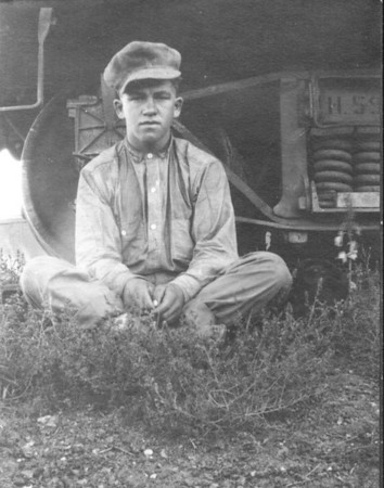 """Riding the Rails: 1912  Bill, at 15 years of age, riding the Soo Line Railroad   He and brother Sam worked the harvest fields in """"Dakota"""" that summer and fall, ending the season by picking corn in Iowa. They moved from town to town by hitching a ride in open boxcars.   This photo taken at Aberdeen, S.D. Grandma Hallie, whom Bill married in 1920, gave me this real photo postcard image and a Soo Line dining car spoon that Granddad found along the rail bed.  John W. Janssen opened a post office at Coalwood in 1912, stocking tobacco, paper, pencils and ink for the locals. As demand grew, the inventory expanded. By 1915, he was running a full-fledged general store: Janssen Mercantile.   John W. found work for his sons, either on the home place, in the mercantile or working out. Bill felled trees for logs, built cabins, worked at a truck garden in Miles City, put up hay at a """"hay camp,"""" worked for ranchers, broke ranch horses and polo ponies, and rode on cattle.   He also attended the Montana Institute, a Miles City business college, for two winters. He and his brother bunked in a stable, eating and cleaning up at the YMCA: """"We stayed at Neal Harding's livery stable and slept in the barn. J.M. Holt was shipping cattle and had a large herd out on Tongue River. These cowboys would come into the barn to change shifts and come in and go out. We didn't sleep much but it was interesting to us, as Sam and I wanted to be real cowboys!"""""""