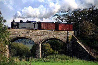 The Railway's Hunslett industrial tank number 7150 works a goods over the three-arch bridge near Avon Riverside on 21 October, 2012.