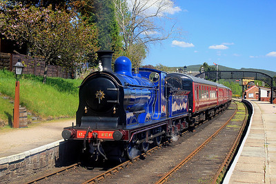 Caledonian Railway 0-6-0 number 828 departs from Boat of Garten with the 11:30 from Broomhill to Aviemore.  26/05/12.