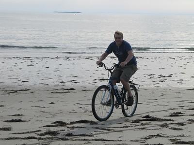 Mike mountain biking on beach