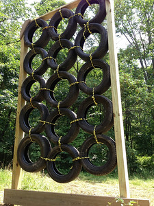 Tire Wall: pitching you side-to-side as you scale up and over this vertical wall!
