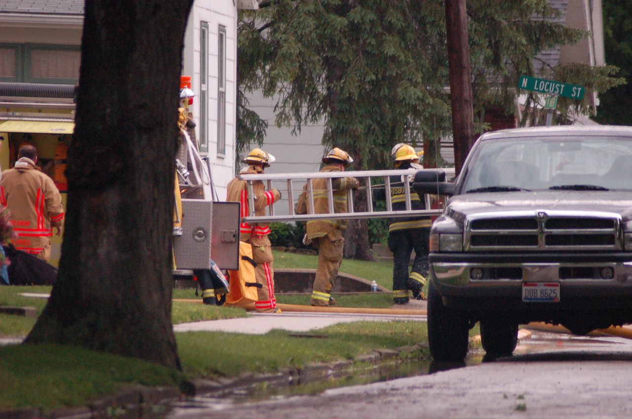 Fire departments from 3 towns responded to several houses struck by kightning.