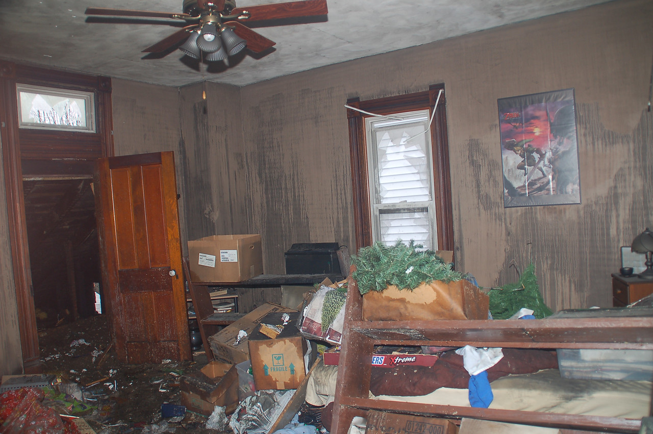 One of the bedrooms on the second floor.   The closetwas emptied and the contents were placed in this room.   Note that even though fire did not reach this room, the contents were damaged.      In a major fire, the area of content damage always exceeds the area damaged by actual fire