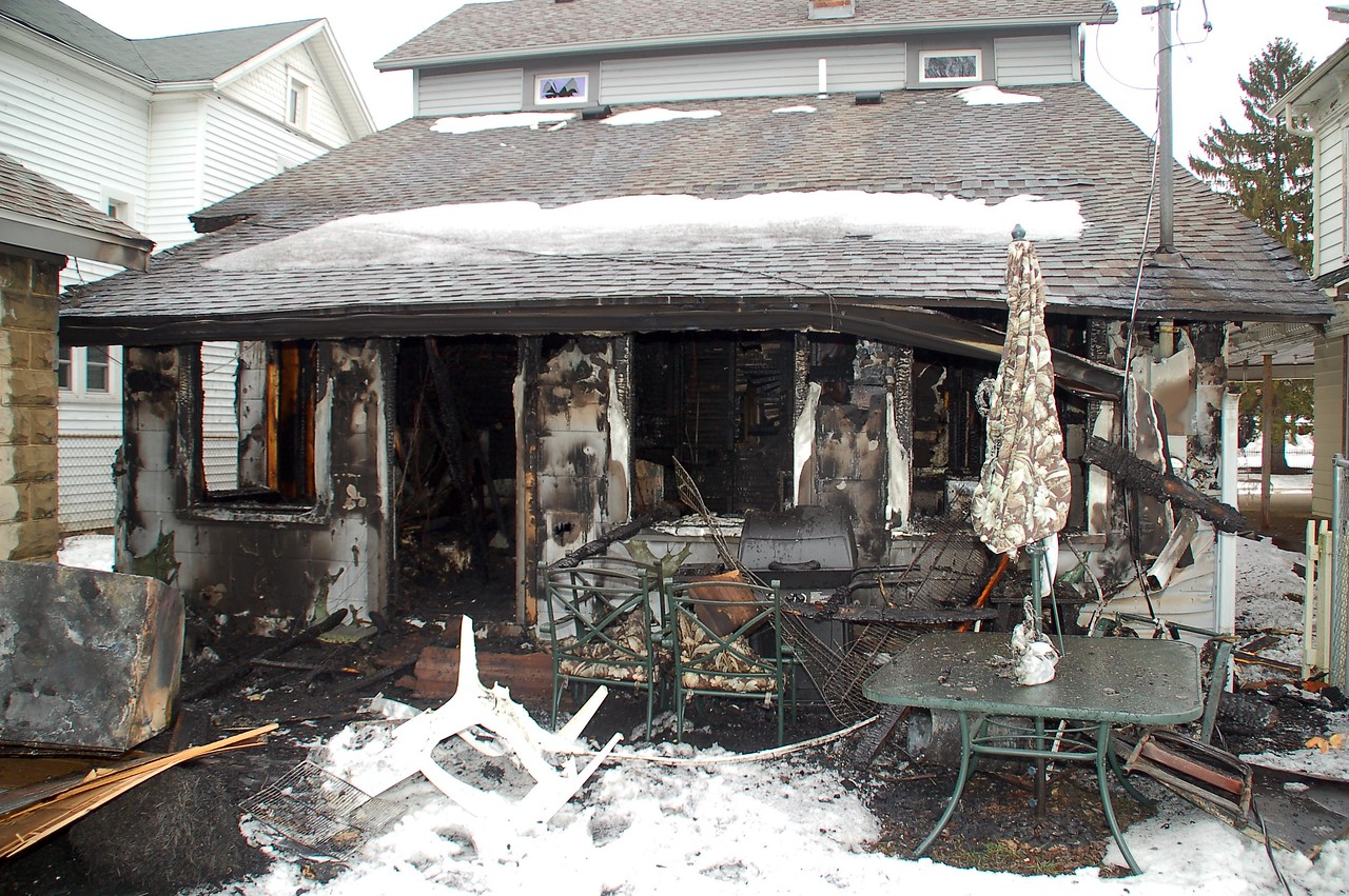 Rear view of home (back porch).   The propane tank of the BBQ had been left on; the regulator melted from the heat and caused a leak.