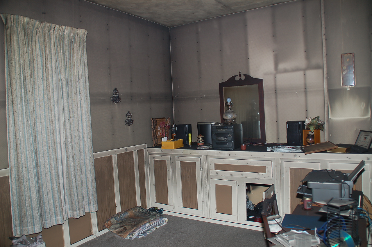 A spare room.   Note how the the smoke clung to certain places on the wall.   These areas had wood behind them which absorbed heat, making that area of the wall cooler.