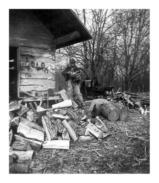 Unknown man at wood pile