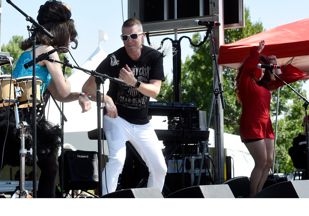 . LONGMONT, CO: August 11: Deb Britton, left,  Steven Blasinski, and Lisa Morgan, of Hey Lady, get the crowd moving. Hey, Lady!, a B-52s tribute band from Longmont, played at Leftapalooza in Longmont on Saturday. (Photo by Cliff Grassmick/Staff Photographer).