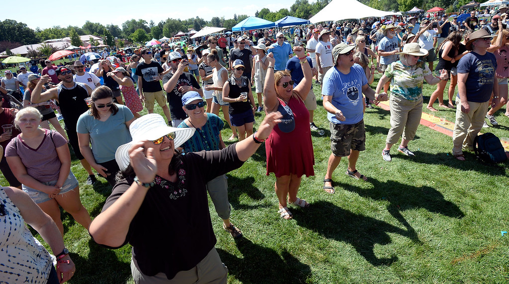 . LONGMONT, CO: August 11: The crowd dances to Hey Lady! Hey, Lady!, a B-52s tribute band from Longmont, played at Leftapalooza in Longmont on Saturday. (Photo by Cliff Grassmick/Staff Photographer).