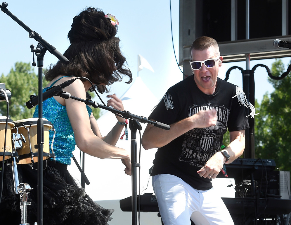 . LONGMONT, CO: August 11:  Deb Britton, left Steven Blasinski, of Hey Lady, get the crowd moving. Hey, Lady!, a B-52s tribute band from Longmont, played at Leftapalooza in Longmont on Saturday. (Photo by Cliff Grassmick/Staff Photographer).