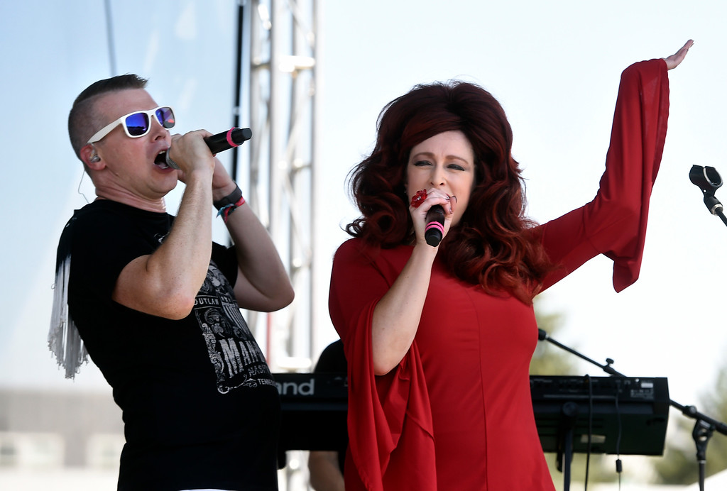 . LONGMONT, CO: August 11:  Steven Blasinski, left, and Lisa Morgan, of Hey Lady, get the crowd moving. Hey, Lady!, a B-52s tribute band from Longmont, played at Leftapalooza in Longmont on Saturday. (Photo by Cliff Grassmick/Staff Photographer).