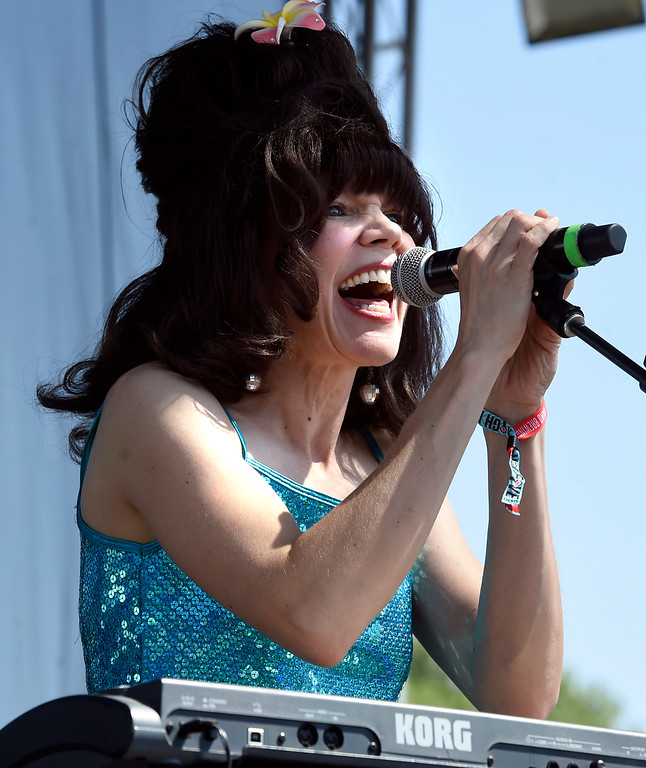 . LONGMONT, CO: August 11:  Deb Britton, of Hey Lady! hits the high notes. Hey, Lady!, a B-52s tribute band from Longmont, played at Leftapalooza in Longmont on Saturday. (Photo by Cliff Grassmick/Staff Photographer).