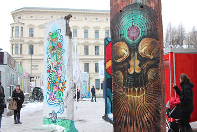 Near Checkpoint Charlie, sections of the Berlin Wall have now been converted to works of art; some political, some for aesthetics.