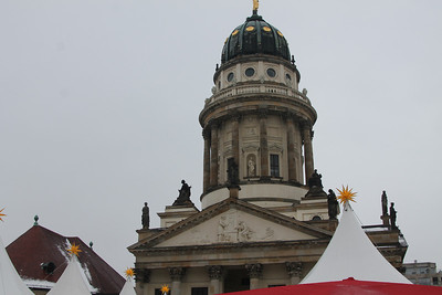 At Gendarmenmarkt. Tents for the Christmas Market monopolized the Square. How barren it looked when we returned in January, and none of its festivity was apparent.