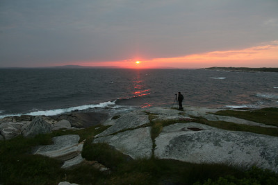 Harry does his thing! (At Peggy's Cove, Nova Scotia).  His pic of the lighthouse earned him an Editor's Pic on another Photo websight! http://www.hepherson.com/Landscapes/Assorted-Lighthouses-in-North/12947836_sZpL5#936255801_xXCAj-A-LB
