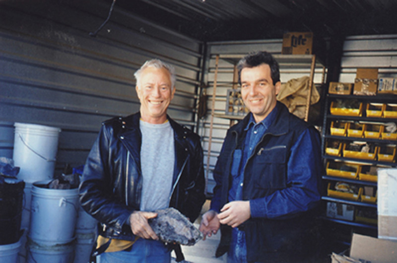 With Johann Zenz in my rock storage shed before he published Agates I, sometime n the late 1990's.  That's a chunk of Morrisonite with pink orbs by the way.