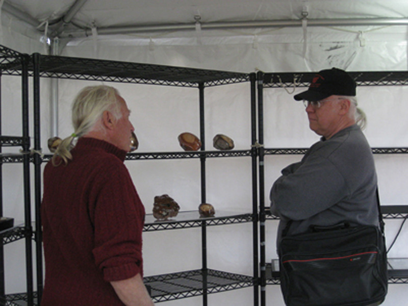 Visiting with Mike Carlson during setup at the 2010 RV Gem Show in Tucson. With all those tails there must be a pony in there somewhere.