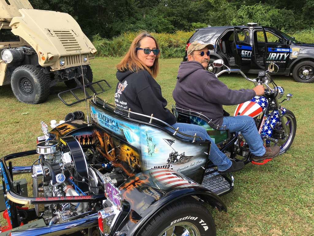 . Allyson and David Thibeault of Dracut on a custom-built motorcycle honoring veterans and the military