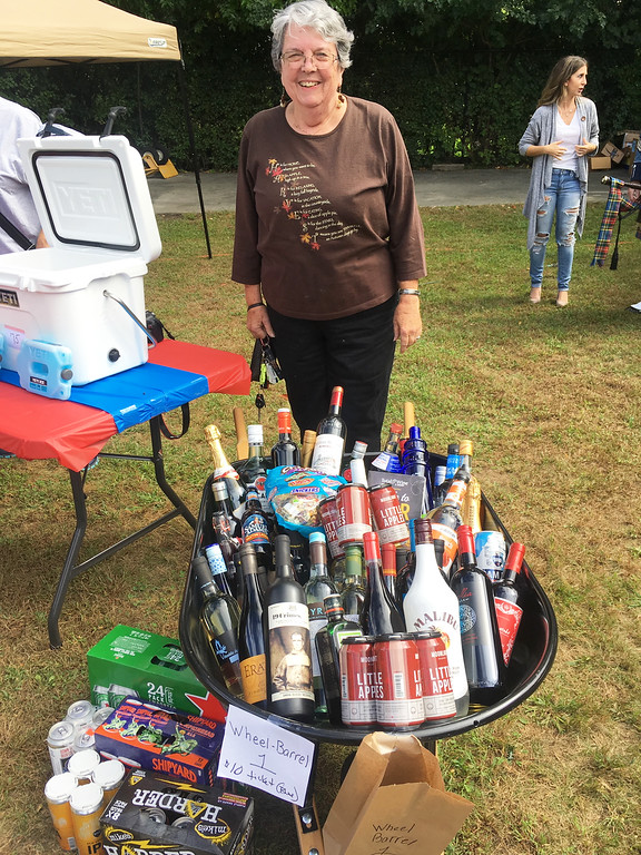 . Patti Mason of Westford offers drinks.