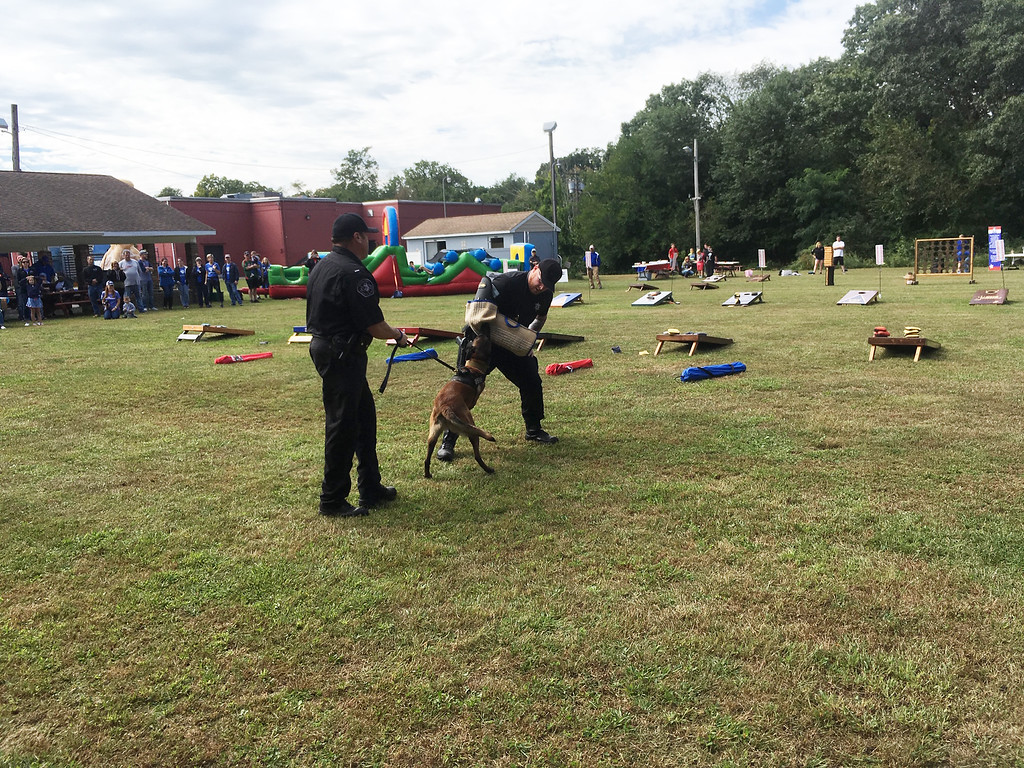 . Lt. Mike Kelly and K-9 Officer John Pimentel show what police dogs can do.