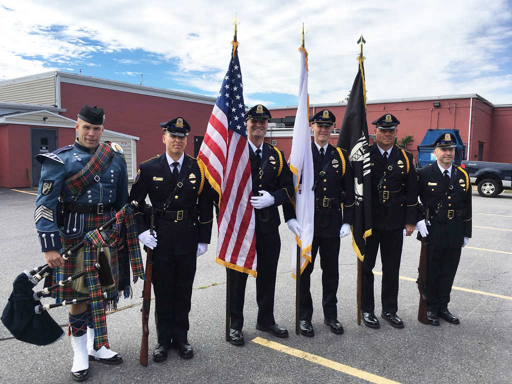 . Bagpiper and State Police Lt. James Bigelow with some of Billerica�s finest