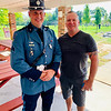 """From left, Sgt. Jeff Lenti, who sang a beautiful rendition of """"God bless America,"""" with Burlington Officer Dan Houston"""