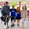 From left, State Police Trooper and bagpiper James Frohock, with Scott Hyder and Leslie Cregg-Hyder of Pelham, and The Z-List
