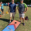 Bob Carrier of Windham, N.H., left, and Chris Khun of Haverhill prepare to toss some bean bags.