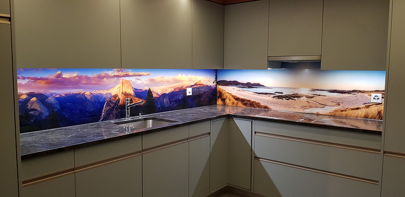 Large glass kitchen backsplash of my image 'Glacier Point Sunset' installed in a home in Switzerland.