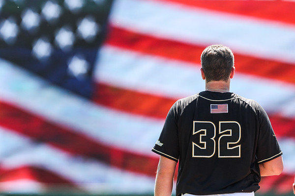 Cal Poly pitcher Darren Nelson stands for the national anthem for a game at Baggett Stadium before a game.