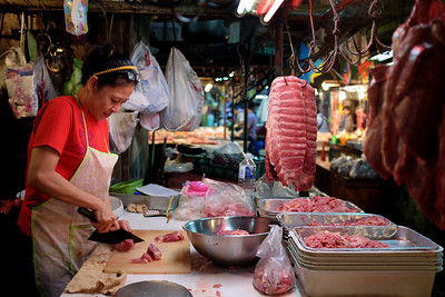 Butcher at Khlong Toei market in Bangkok, Thailand.