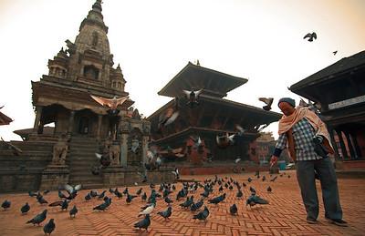 Feeding pigeons in Bhaktapur, Nepal.