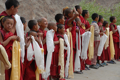 Young monks awaiting the arrival of the head Lama of their monastery (Likir)