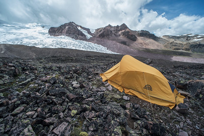 A campsite high in the Andes not far from the edge of a receding glacier.  As the glacier melts and recedes frogs living below it colonize higher and higher into the mountains.