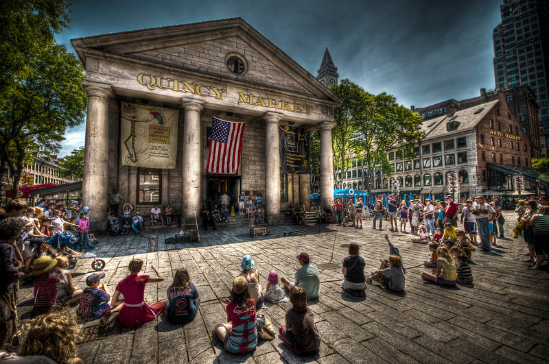 """Quincy Market Audience""<br /> <br /> An audience watches a unicycle performer.<br /> <br /> I am particularly proud of this one as it is a 5 exposure hand-held HDR shot that resulted in very little ghosting."